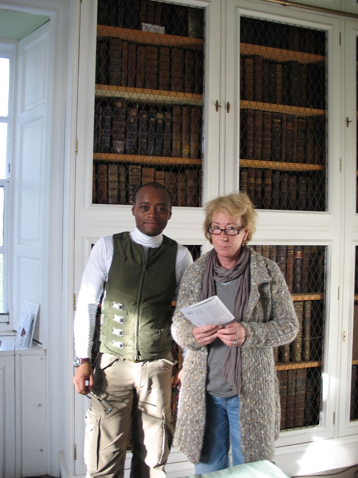 Actors Fraser James and Ellie Haddington on location at Innerpeffray Library.