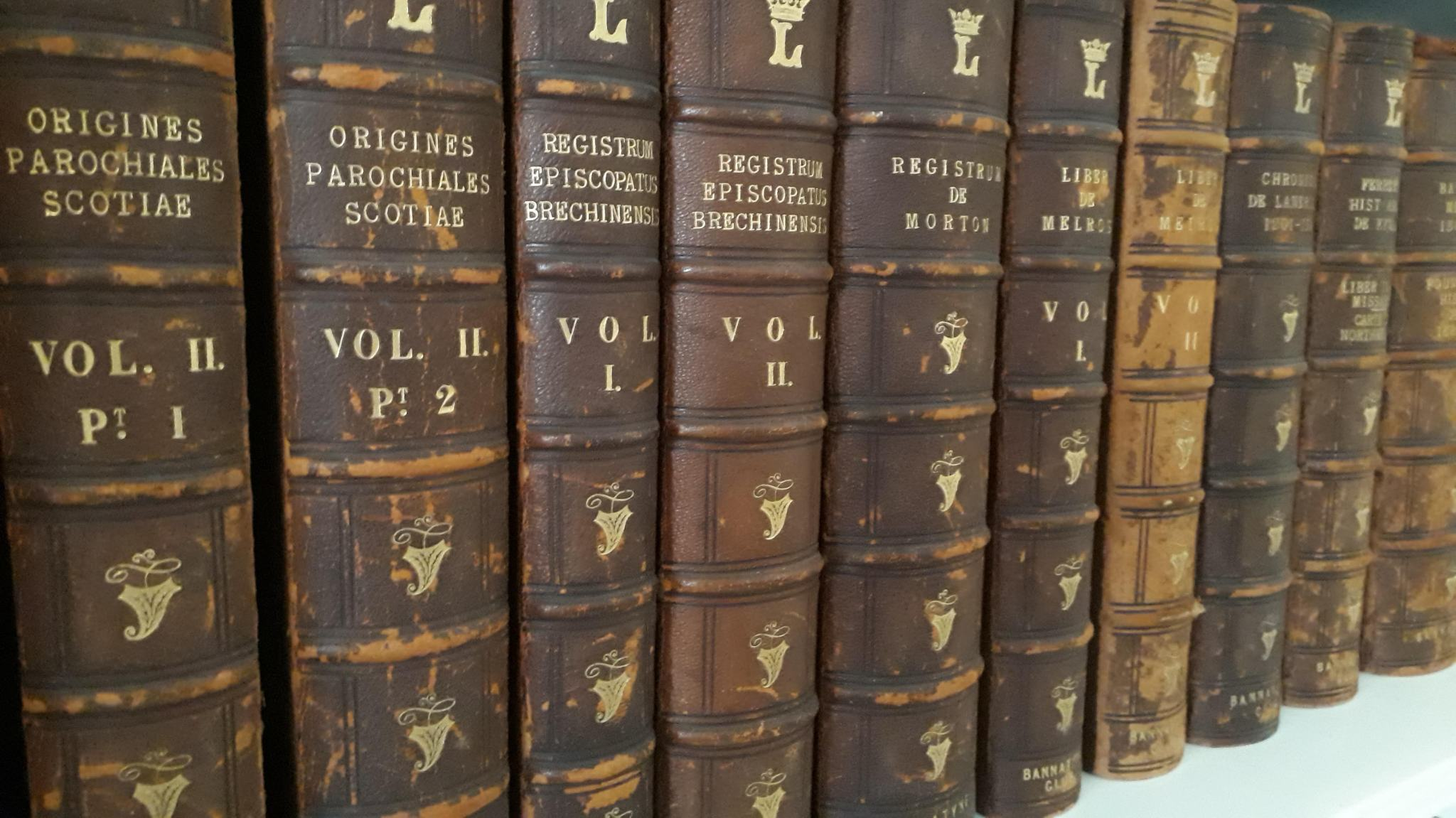 Bannatyne Club publications from the library of the Marquess of Lothian in his personalised bindings.